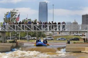 Dignitaries pour Champagne on Thursday during the dedication of the Riversport Rapids in Oklahoma City Photo By Steve Gooch, The Oklahoman